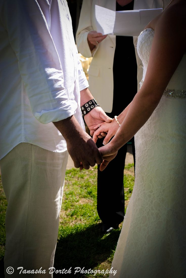 Couple holding hands at wedding!