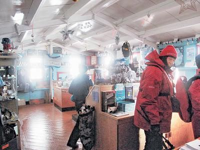 Antarctica post office seeking job applicants who can dodge 'smelly penguins,' live without showering. Port Lockroy, located on Goudier Island off the Antarctic Peninsula. Post office and gift shop. Blue walls.