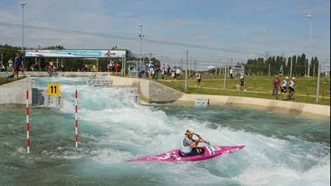 The Lee Valley White Water Centre is located 30 kilometres north of the Olympic Park, on the edge of the 1,000-acre River Lee Country Park.  The centre has two separate courses: a 300 metre Olympic-standard competition course with a 5.5m descent, & a 160m intermediate/training course with a 1.6m descent. Both courses were built from scratch, along with a 10,000 sq metre lake.This feeds a system of pumps providing the course w/ 15 cubic metres of water per second.