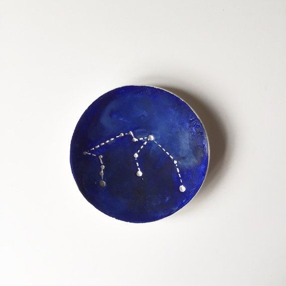 Constellion Star Sign Zodiac Jewellery Dish  Handcrafted, hand painted individual star sign ring dishes Perfect for birthday gifts  Each dish is individually cut from cold porcelain with each star sign imprinted within inner face of dish Then hand painted in a night sky array of dark acrylic tones and varnished  These lightweight, Palm sized, dishes are absolutely delightful and would make a perfect, unique, birthday gift   As each dish is handcrafted to order they may have slight…