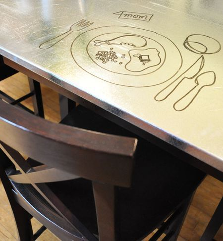 Sheet metal table top...and you can draw on it with dry erase markers!!!