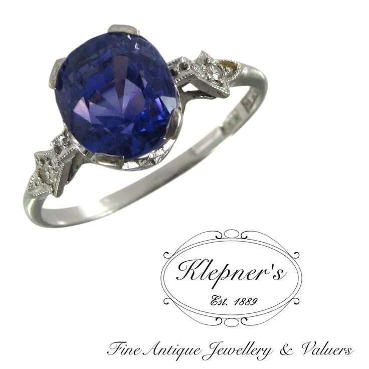 18ct white gold vintage blue Celyonese sapphire& diamond ring, circa the 1950s, claw set with one 4.25ct oval brilliant cut sapphire & grain set with two single cut diamonds on each shoulder totalling 0.03ct. Visit us at www.klepners.com.au