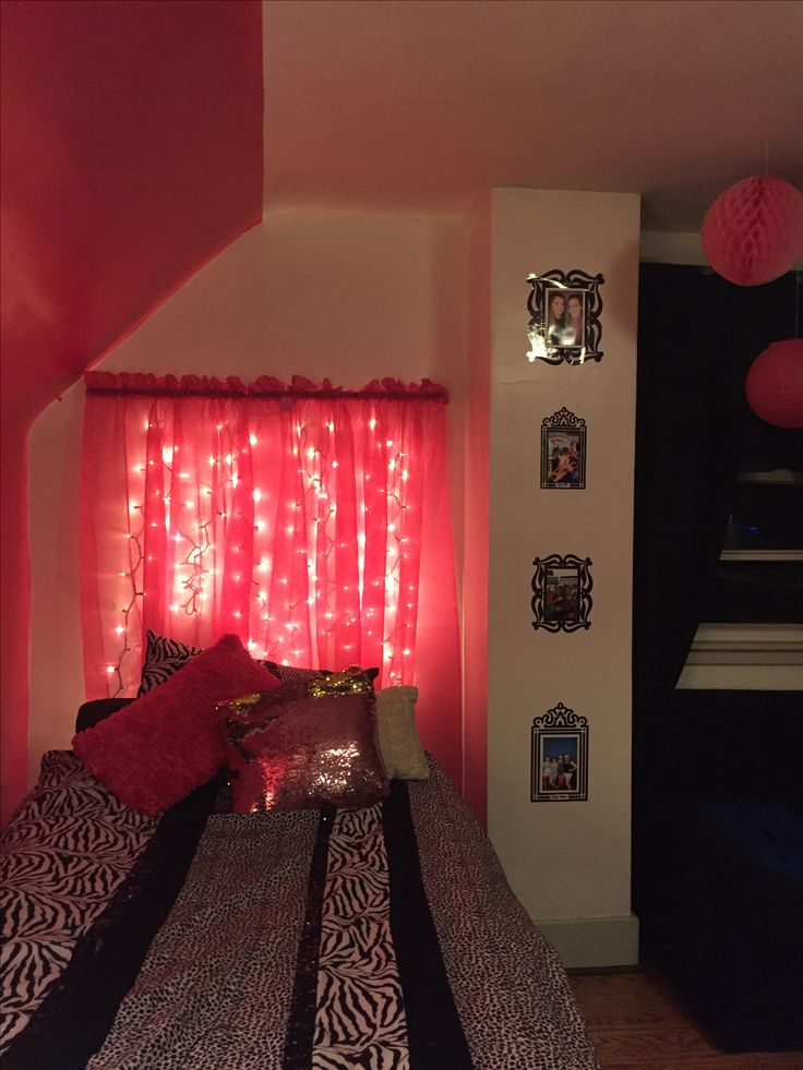 Lighted headboard for Kelseys room. Curtain rod, pink sheer, white Christmas lights.
