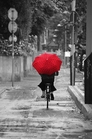 Red umbrella and on the move. I can't stop now i'm in my groove