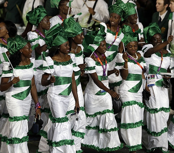 Nigerian athletes walk in a parade during the Opening Ceremony at the 2012 Summer Olympics, Friday, July 27, 2012, in London. (AP Photo/Mark Humphrey)
