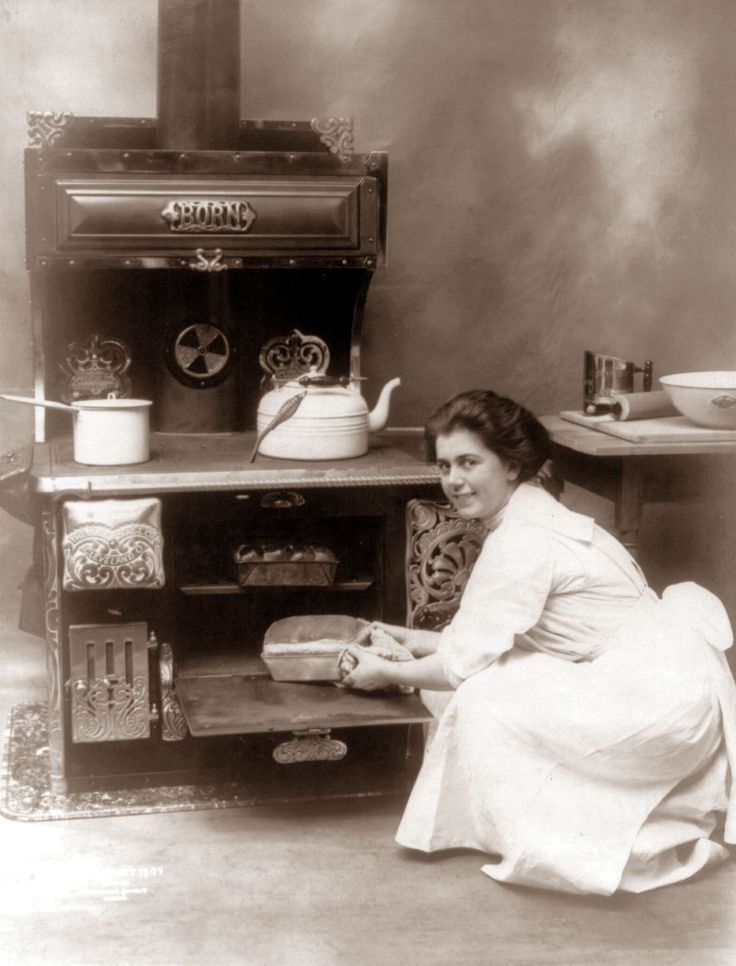 Making bread in a wood-fired stove. I not even THAT old and remember my granny doing this in the early 60's