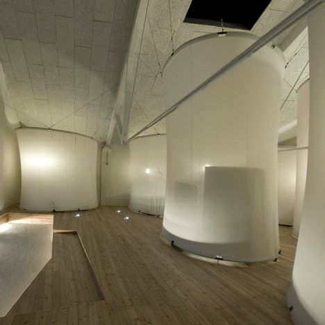 MiNO pods -- Italian studioAntonio Ravalli Architetti have converted an old factory in Migliarino, Italy, into a youth hostel where guests can stay in these tall fabric-covered pods.