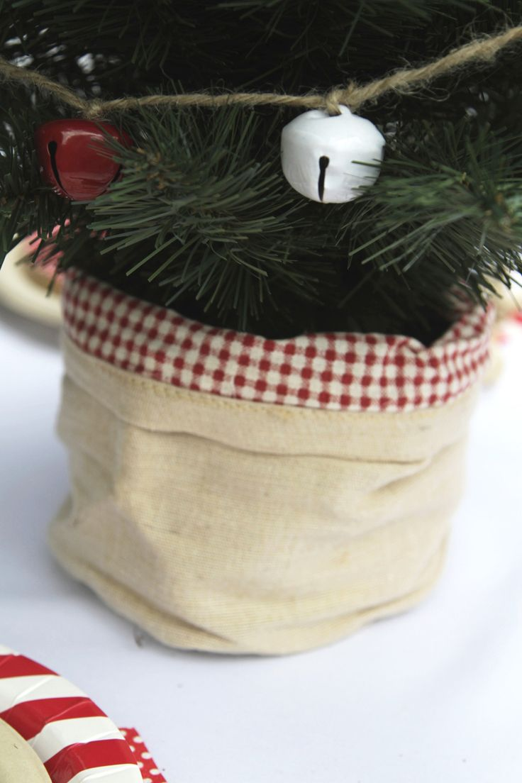 Linen sack with red gingham trim, perfect to hide the base of your mini table top Christmas tree | The Paper Lantern |