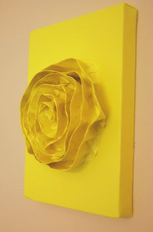 DIY Fold painter's tape in half so it sticks to itself, form into the shape of a flower, stick it to canvas, and paint. (or try with duct tape)