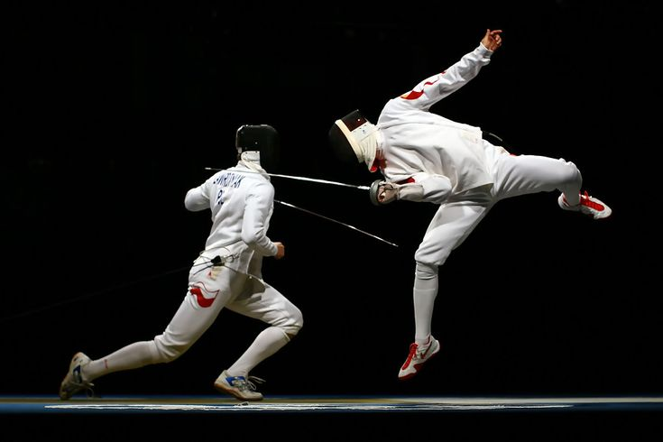 Li Guojie of China jumps up for a touch against Radoslaw Zawrotniak of Poland in the semifinal of the men's team epee fencing event at the Fencing Hall on Day 7 of the Beijing 2008 Olympic Games on August 15, 2008 in Beijing, China.