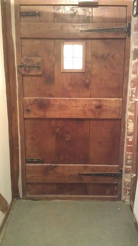 12. Back of Antique Solid Oak door with suffolk latch and T hinges