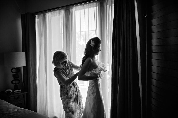 Port Douglas Wedding Photography. Elise's putting on her wedding dress with some help from mum. www.shaunguestphotography.com.au