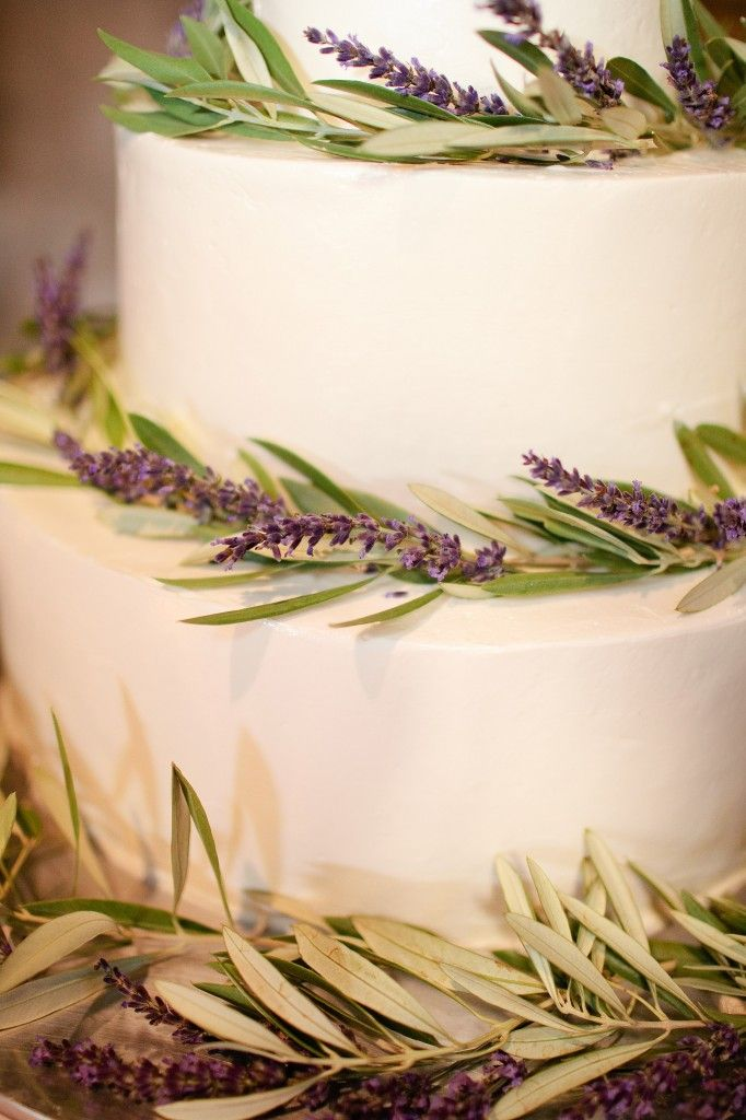 cake decorated with lavender and olive branches
