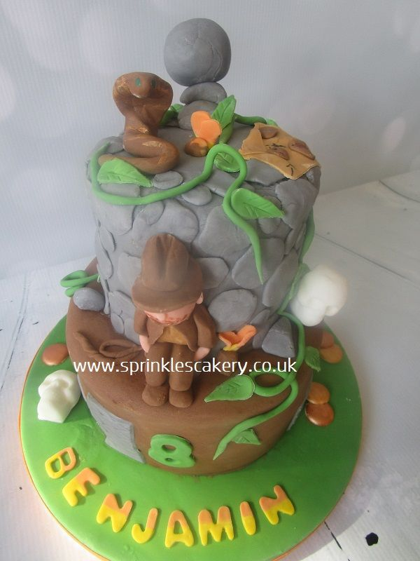 This was for an Indiana Jones fan to celebrate his birthday. All the novelty decorations were hand modelled from fondant.