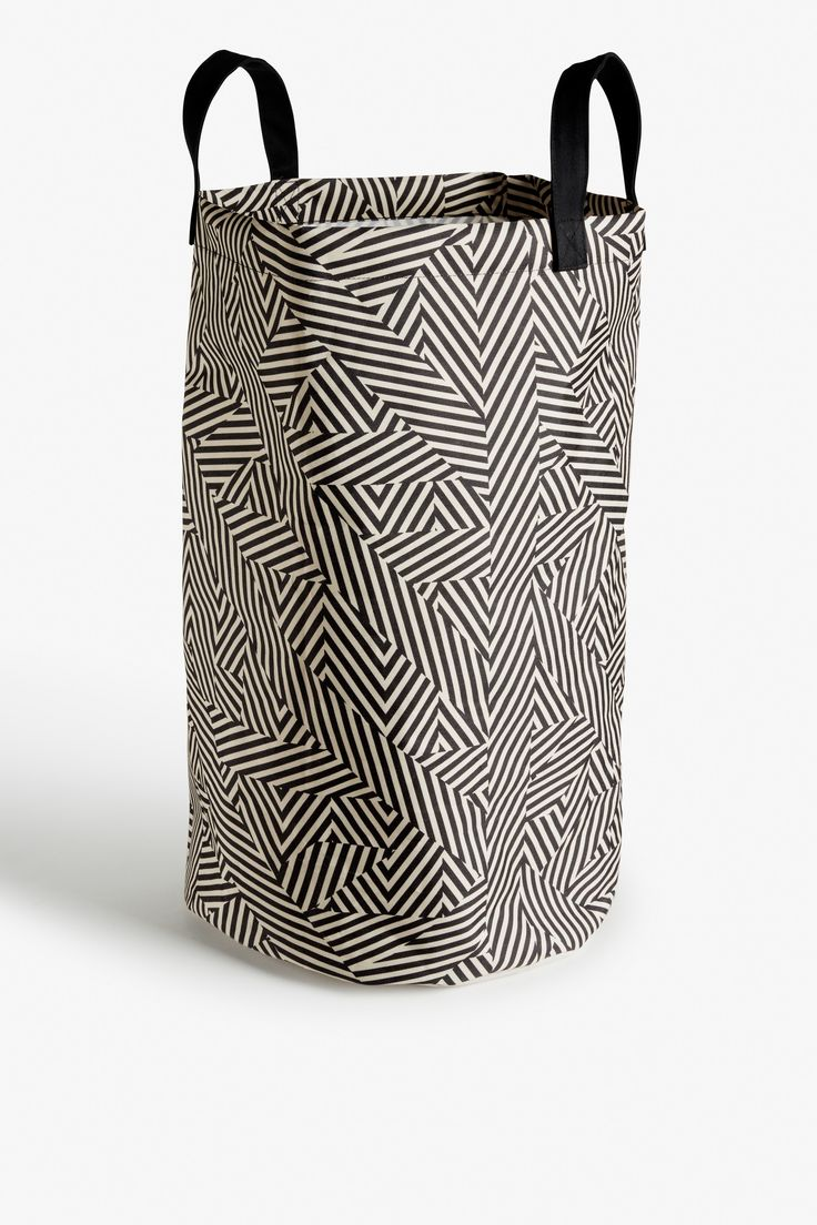Curve your enthusiasm to this funky home wear! The most perfect laundry bag to tote too and from with, and in a print that's packing a whole lot of artsy energy why would you settle for a plain old one?