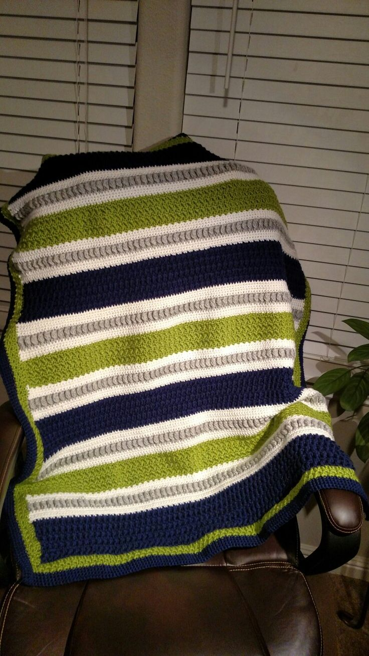"""""""Stitch Play blanket"""" by Luckylizard Crochet using the """"Confetti Baby Blanket"""" for inspiration. I used a different stitch for each colored stripe, creating texture and eye appeal! #crochet #crochetbaby #texturedbabyblanket  #crochetstripes #stitches #seahawks"""