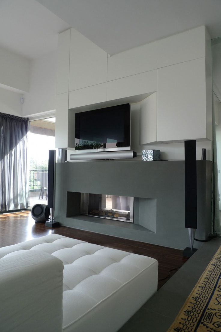tv wall unit with fireplace below