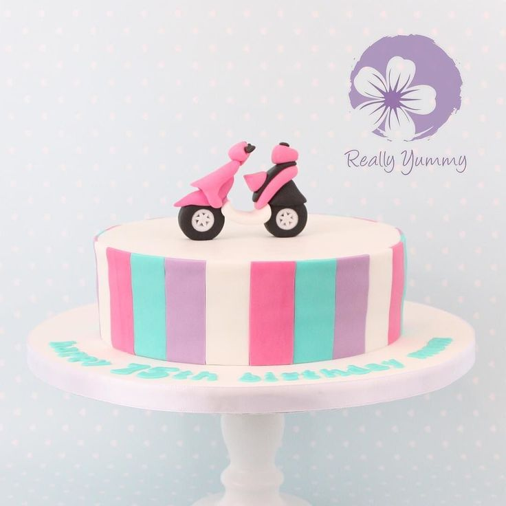 A pink moped cake  #reallyyummycakes #cakedesigner #bespokecakes #hampshirecakes #winchestercakes #cakes #moped #pinkmoped