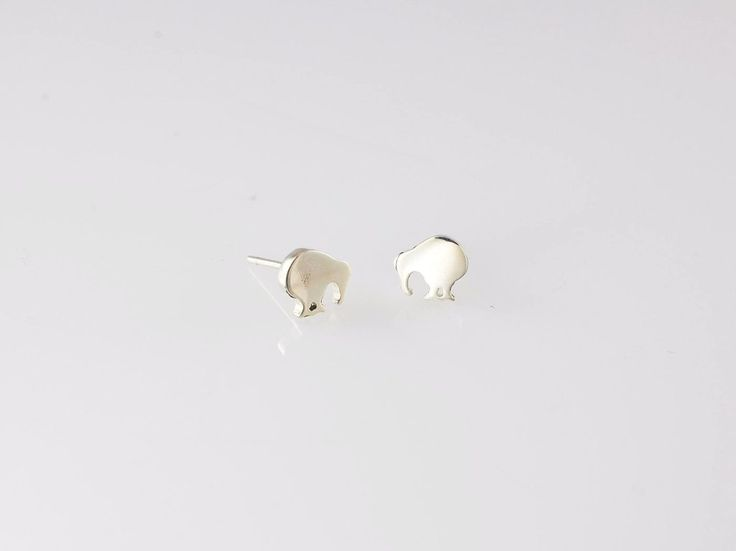 Kiwi Bird Stud Earrings. NZ$79 Silver. These little Kiwi bird earrings are a simple and stylish iconic New Zealand design. Our unofficial national symbol makes a perfect gift or souvenir of New Zealand. Small and lightweight makes them easy to post. Jewellery made @jewelbeetle in Nelson, New Zealand.
