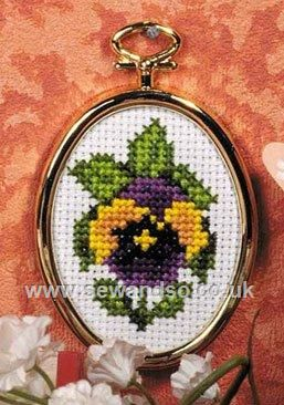 "Framed Pansy Cross Stitch Kit (pre-printed background) 2"" x 2.5"" (5cm x 6cm). Kit contains easy instructions, needle, 14 count Zweigart Aida fabric - pre-printed with design background, gold coloured frame and DMC stranded cotton threads. © Orchidea.  Price approx. £5"