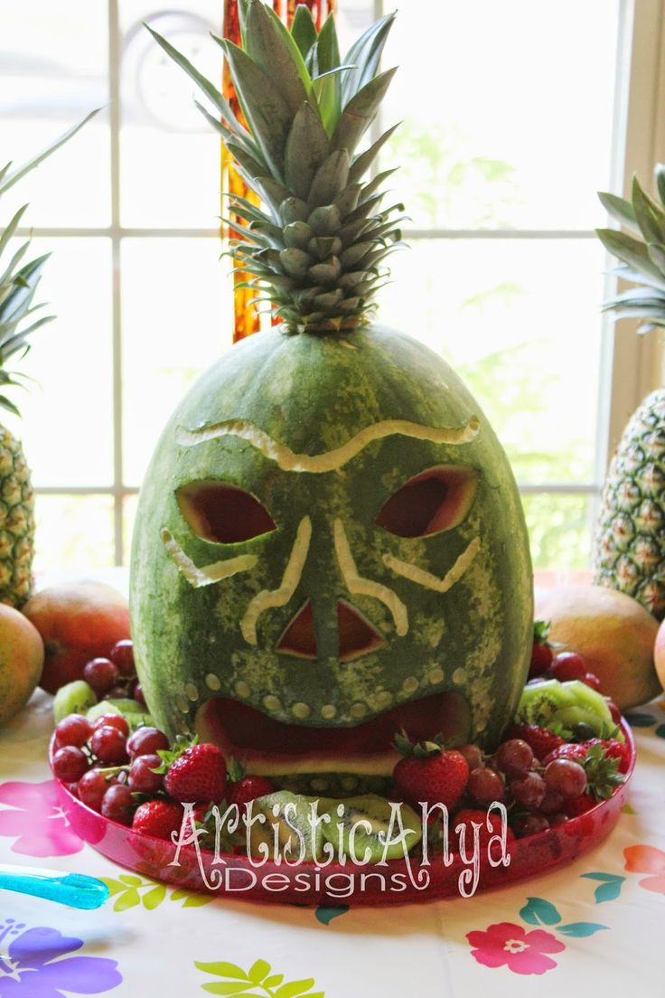 Hawaiian Luau Theme - Carved watermelon tiki mask! Put a tea light inside the head and at night time this might freak a few people out. Certainly would me...
