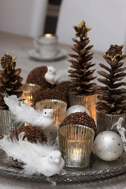 Cute idea for Christmas centerpieces or on endtables or a long hallway able. Pinecones, candles, ornaments, snowbirds...