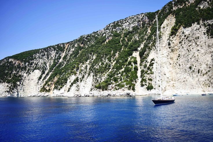 Explore the cliffs and bays in Ithaca, Greece on a chartered sailing holiday.