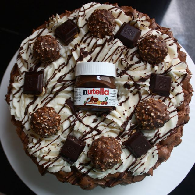 The most best Nutella cake in the world. Velvety chocolate cake, filled with Nutella, covered in Nutella buttercream, and topped with Ferrero Rocher and Ritter Sport! Step by step instructions to make your own insane Nutella cake!