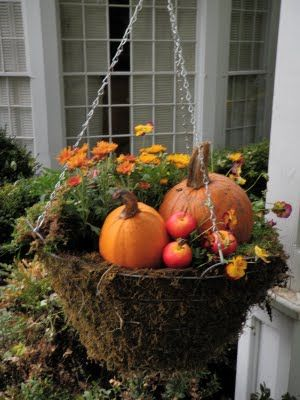 Fall Decorating Idea: Hanging basket with golden mini mums, pansies, pumpkins and faux lady apples.