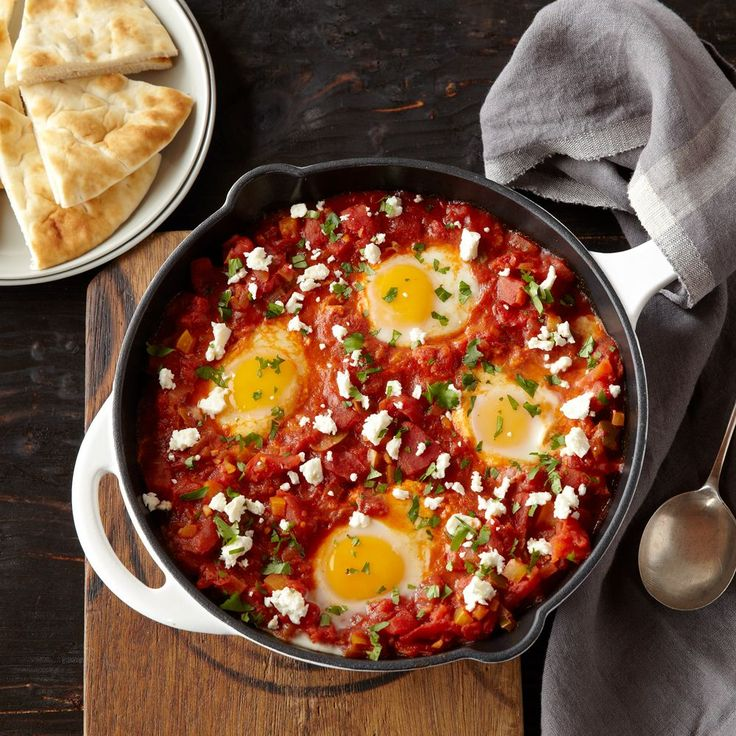 Spicy Shakshuka : Hunt's® and Ro*Tel® come together with  sweet bell pepper, smoked paprika, crumbled feta cheese and perfectly baked eggs to create a spicy, flavorful breakfast dish the whole family will love