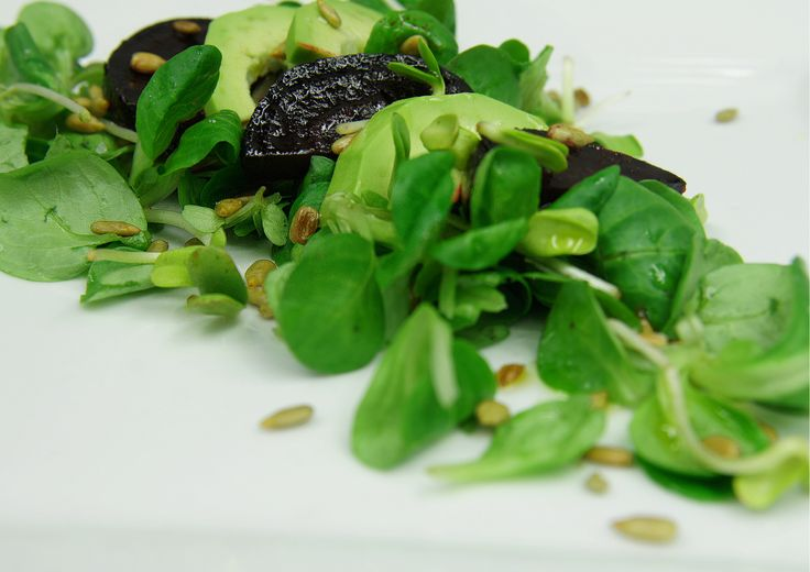 Salad with avocado and glazed beets.