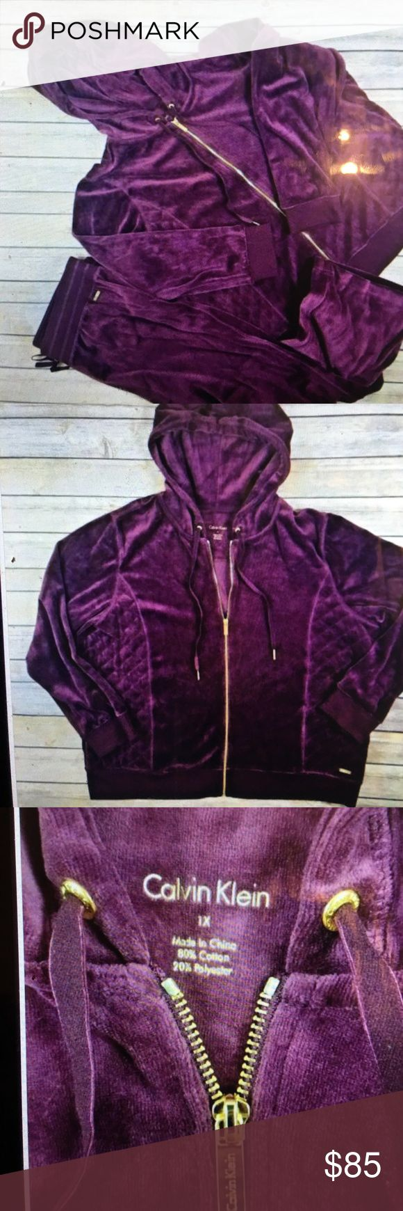 Calvin Klein Velour 1X purple hoodie Tracksuit New:  Pants has tag attached but Jacket does not. : Velour Hoodie tracksuit.  Women size 1 X Brand: Calvin Klein. purple Velour tracksuit includes pants and zip up hoodie jacket. Calvin Klein Pants Jumpsuits & Rompers