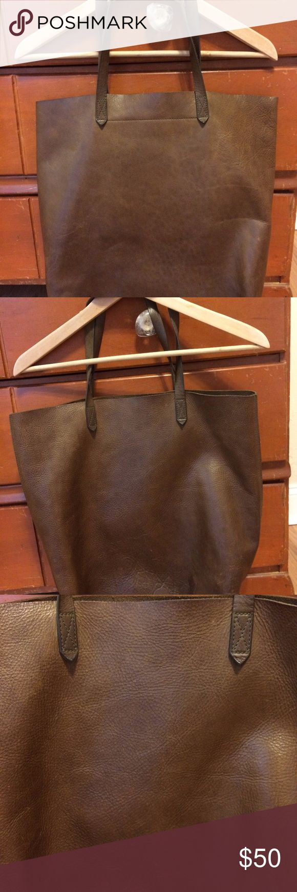 """Madewell Transport Tote What goes into our signature tote? Here it is by the numbers: 2 pieces of fine leather are used for the body. 8 inch strap drop: long enough to sling over your shoulder, but short enough to hold as a top handle. 1 interior side zip pocket to keep your keys, phone and wallet at the ready.  Made of vegetable-tanned leather that burnishes with wear into a beautiful patina. Interior zip pocket. Unlined. 8 1/4"""" handle drop. 14""""H x 14""""W x 6""""D. Madewell Bags Totes"""
