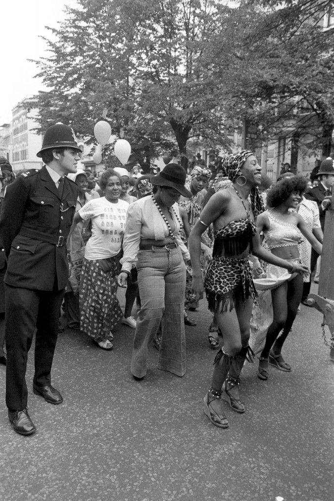Watched by a policeman some of the carnival go-go dancers find the beat as they follow a steel band float in the eleventh Notting Hill Carnival, which today entered its second and final day at the West London district. Ref #: PA.7694381 Date: 30/08/1976