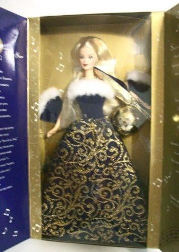 Barbie Ring In The New Year  Ring in the New YearTM #Barbie #Doll wears a royal blue and golden brocade floor-length dress trimmed in white faux fur and a matching royal blue stole lined in golden fabric. Accessories include stud earrings and a golden necklace with a single blue stone.""