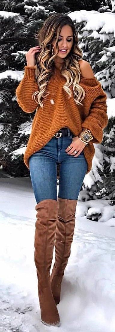 #winter #outfits brown sweater and blue denim bottoms with brown suede knee-high boots