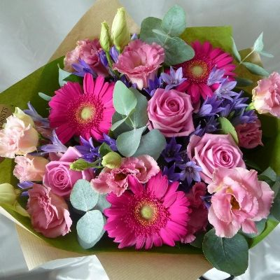 A bouquet of pink flowers with a touch of purple and white. Complemented by a subtle shade of Eucalyptus green.  Part of our Mothers Day 2016 Collection.