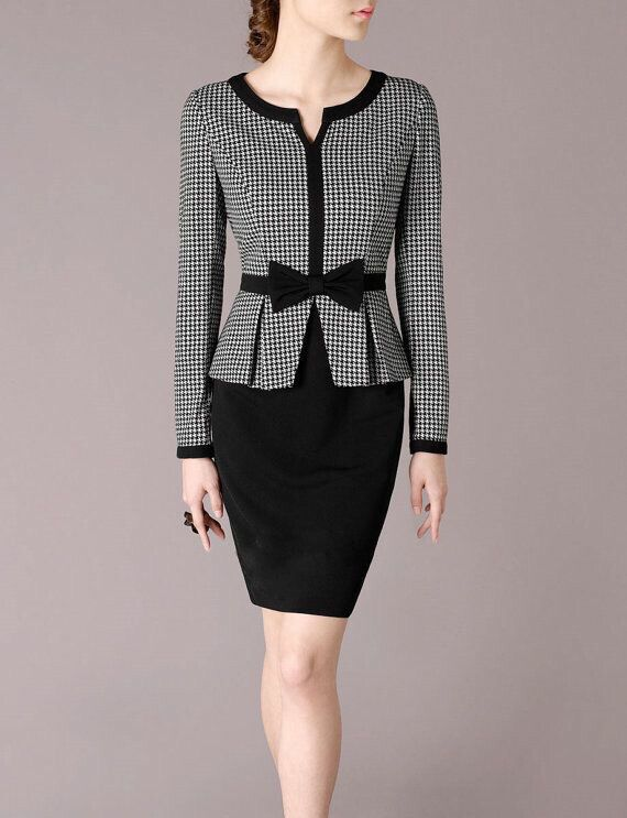 Checked blouse with black trimmings on collar, front & sleeves. A black ribbon in d front & a matching black skirt