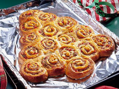 Holiday Sausage Rollups | MrFood.com Could make Cinnamon Rolls in tree shape and use green icing and cherries for decorations.