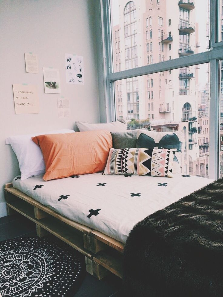 Create a cozy place in a window to relax with just a few pillows and a soft throw.