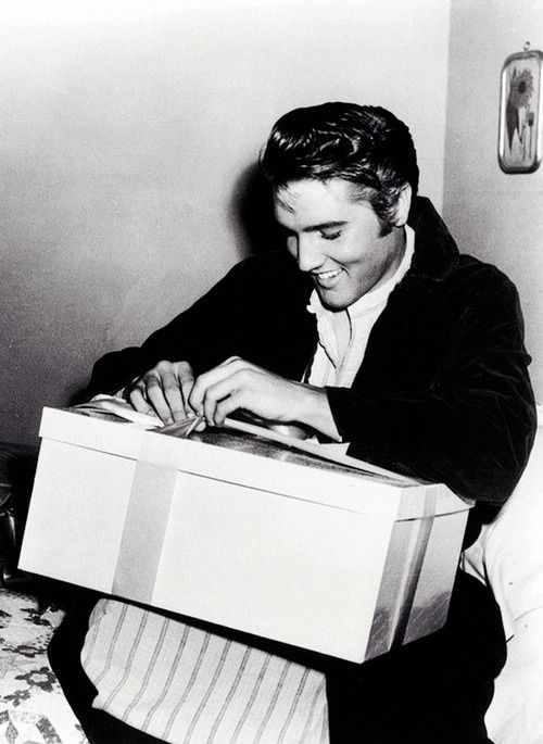 "Elvis during shooting of ""Love Me Tender"" opening a birthday gift from Debra Paget, January 1956"