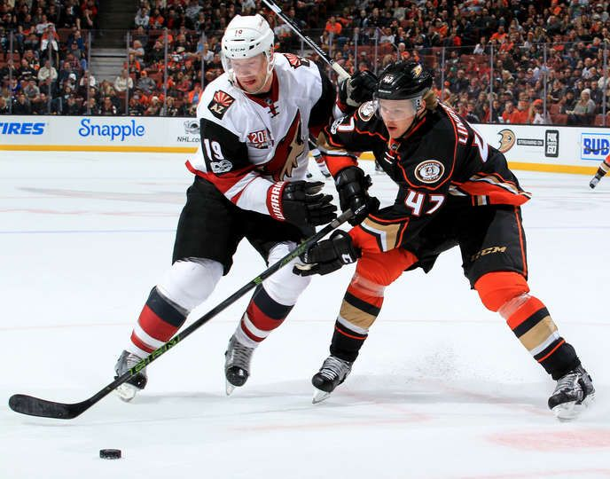 Hampus Lindholm 47 of the Anaheim Ducks battles for the puck against Shane Doan 19 of the Arizona Coyotes