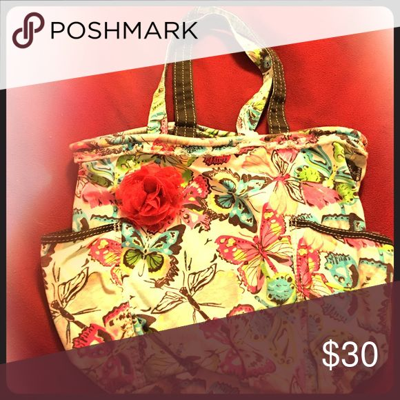 Thirty-one Retro Metro Bag in Flutter Print Retired print, Flutter, with additional magenta rosette clip. Thirty-one Bags Hobos