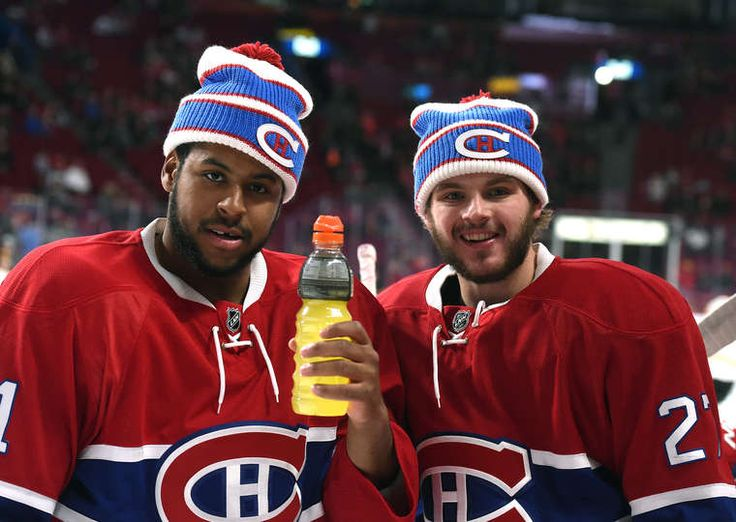 11.7.15 - Bruins vs Habs - Devante Smith-Pelly #21 and Alex Galchenyuk #27 of the Montreal Canadiens warm ups wearing a Winter Classic hat before the NHL game against the Boston Bruins at the Bell Centre in Montreal, Quebec, Canada. (Photo by Francois Lacasse/NHLI via Getty Images)