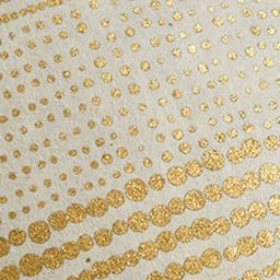 An intricate design in gold and cream meets century-old Nepalese craftsmanship with this polka-dot printed Lokta fine paper. The renewable Lokta plant's long fibers are remarkably strong, giving Lokta