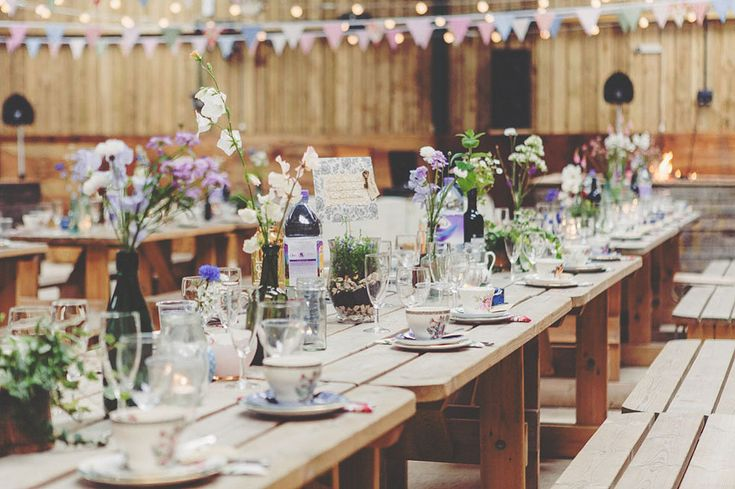 Table set with vintage crockery and wild flowers for a country farm wedding | Photography by http://thetwinsweddings.co.uk/