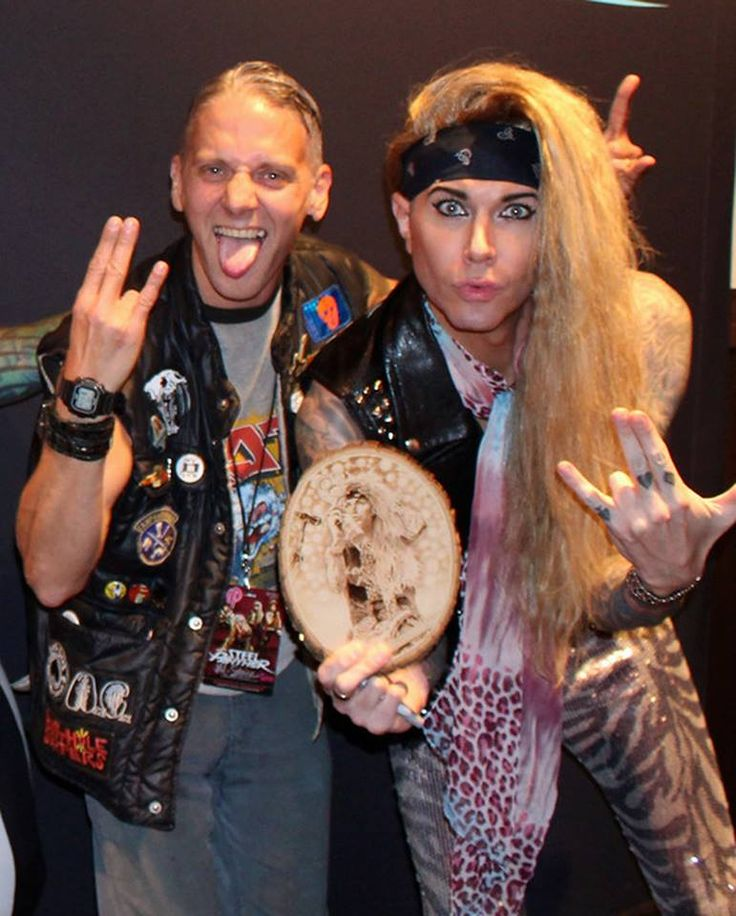 Me and lexxi foxx (steel panther) with the pyrography I did for him at the steel panther show at the Hammond Horseshoe. notice the double shocker! I can't believe I forgot to take a picture of it before I gave it too him. DOH!!!! #steelpanther #fanther #fanthers #fanthersworldwide #kreepykentucky #joshuamason #pyrography #woodburning #metal #heavymetal #hammondcasino #steelpantherhorseshoecasino #fanthersworlkwide #lexxifoxx  — with lexxi foxx (steel panther) at Hammond horseshoe casino…
