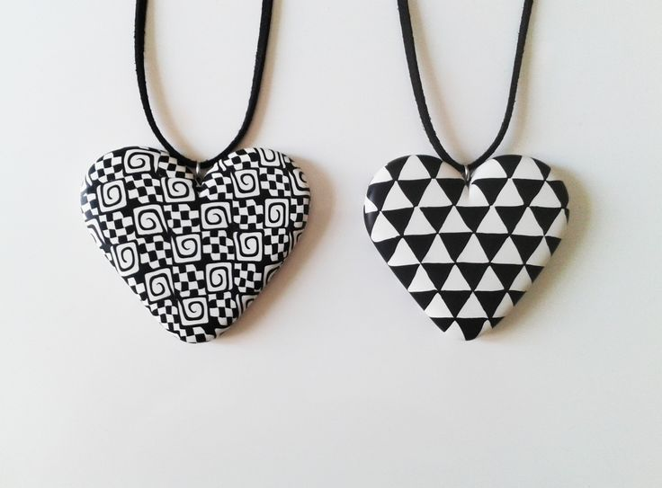 handmade polymer clay heart pendants decorated with black & white patterns