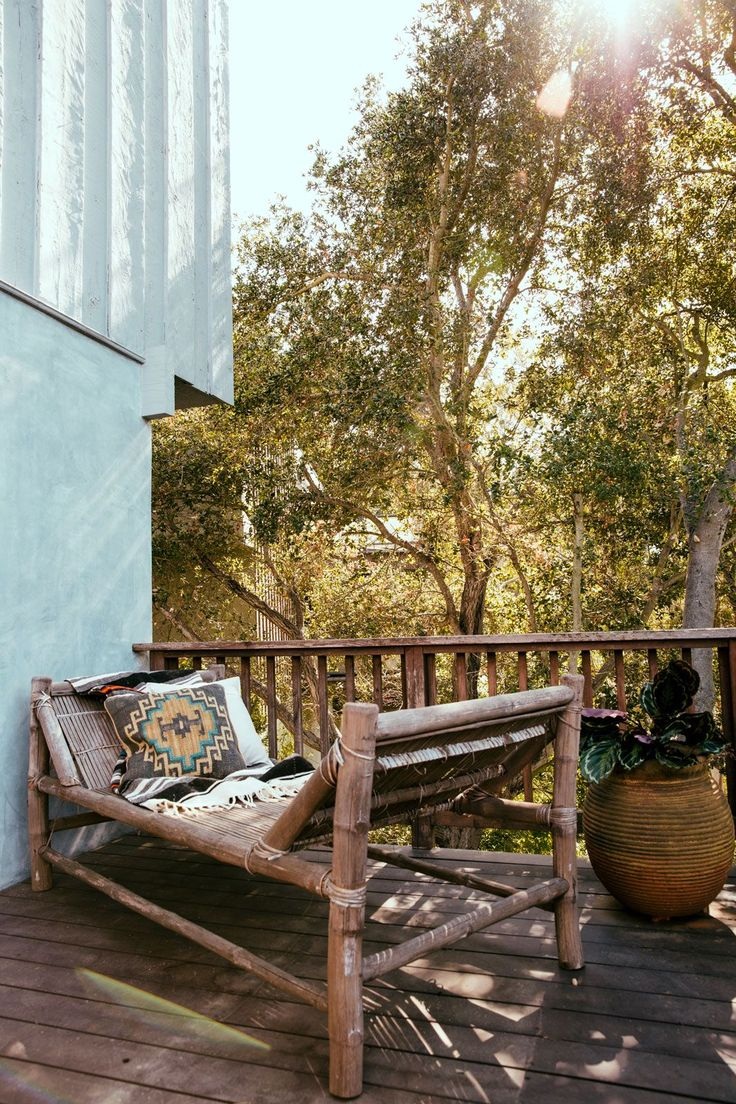 The house has three (yes, three!) beautifully-weathered wooden decks overlooking the canyon. The bottom level is attached to the master bedroom, and has been left almost completely bare. A vintage lounger and potted plant reside on the quietest of her outdoor spaces. #refinery29 http://www.refinery29.com/riawna-capri-home-tour#slide-10