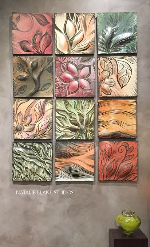 Beautiful botanical designs hand carved into porcelain tiles - ready to hang as wall art or to grout in place for a unique backsplash.